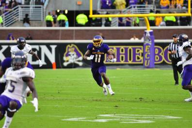 ECU triple-threat James Summers gave a glimpse of the damage he would inflict on N.C. State last Saturday when he rushed for 95 yards on 10 carries in ECU's opener against Western Carolina the previous week. (Bonesville Staff photo)