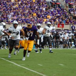 ECU defensive lineman Demage Bailey pursues Knights quarterback Justin Holman.