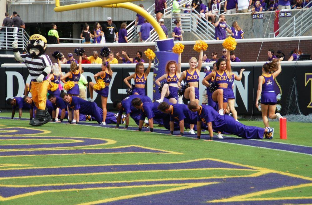 100116-09_cheerleaders-get-their-push-ups-in-after-an-ecu-score-cutline-dsc_0294_1000x660