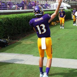 True freshman quarterback Reid Herring makes a toss on the sideline.