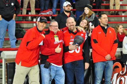 Kevin Youkilis (with cap) was a special guest at Cincinnati's homecoming. The hometown product played baseball for the Bearcats and spent most of his MLB career with the Boston Red Sox.