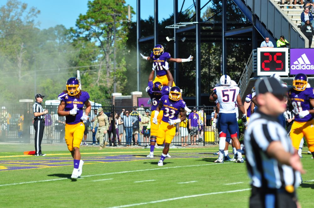 The Pirates were flying high after a 41-3 homecoming win over UCONN, much like James Summers (11) after putting the Pirates on the board in their opening drive (Bonesville Staff photo)