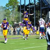 The Pirates were flying high after a 41-3 homecoming win over UCONN, much like James Summers (11) after putting the Pirates on the board in their opening drive (W.A. Myatt photo)
