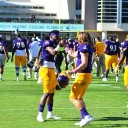 James Summers (11) and Philip Nelson (9) embrace after a 41-3 homecoming win over Connecticut (Bonesville Staff photo)