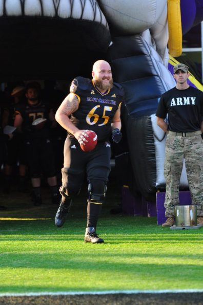 Center J.T. Boyd comes out of the tunnel for his final home game as a Pirate. (Bonesville Staff)