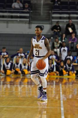 Pirates guard B.J. Tyson surveys the floor. (Al Myatt photo)