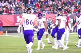 Jimmy Williams (81) is surrounded by teammates after a 13-yard touchdown catch on ECU's first possession. (Al Myatt photo)