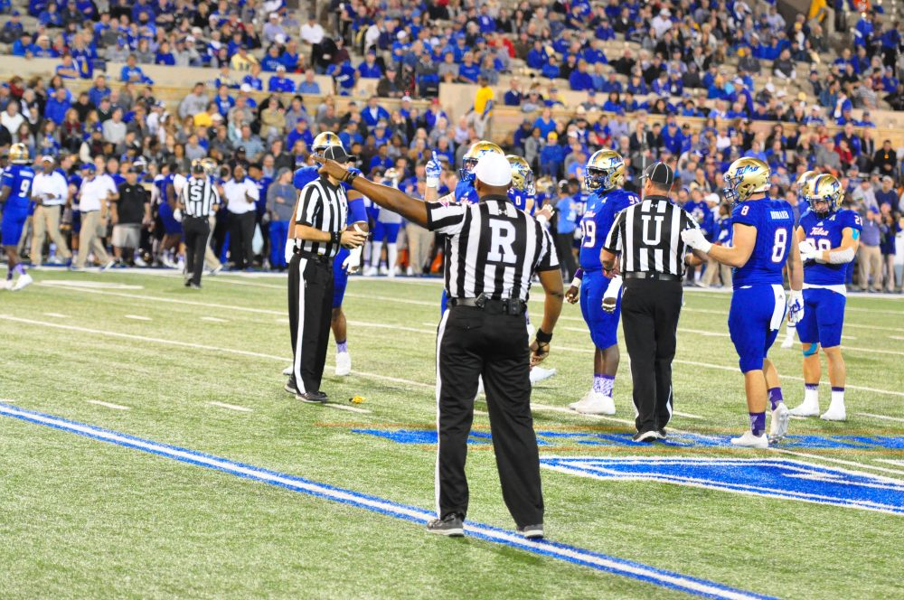 Referee Tracy Jones indicates a penalty against East Carolina, one of may infractions the Pirates committed in their 45-24 road loss to American Athletic Conference foe Tulsa on Saturday night, Nov. 5, 2016. (Photo by Al Myatt)