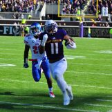 James Summers blazes along the sideline at Dowdy-Ficklen Stadium on Saturday. (W.A. Myatt photo)