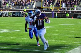 James Summers blazes along the sideline at Dowdy-Ficklen Stadium on Saturday. (Bonesville Staff photo)
