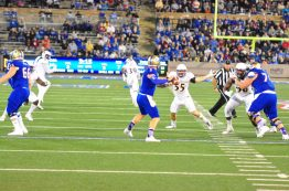 ECU is in pass coverage as Tulsa's Dane Evans looks to throw.