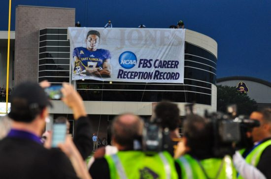 Zay Jones looks on from midfield as the banner commemorating his accomplishment is unfurled. (Bonesville Staff)