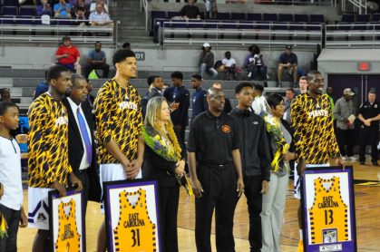 ECU's seniors, with family members, are from left, Caleb White, Andre Washington and Michel Nzege (Al Myatt photo)