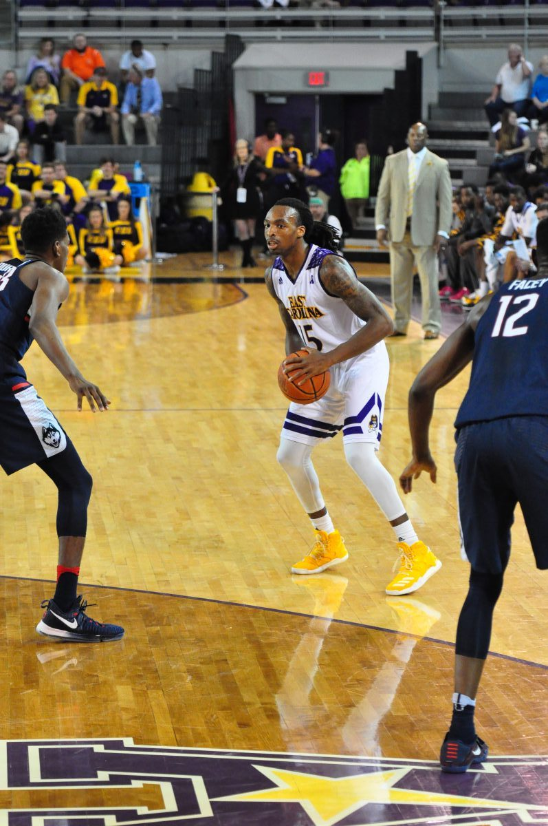 Kentrell Barkley checks the UConn defense as interim ECU coach Michael Perry looks on in the background (Al Myatt photo)
