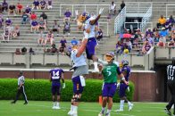 Center Garrett McGhin lifts senior wide receiver Jimmy Williams in the air after a touchdown reception as quarterback Gardner Minshew looks on. (Photo by W.A. Myatt)