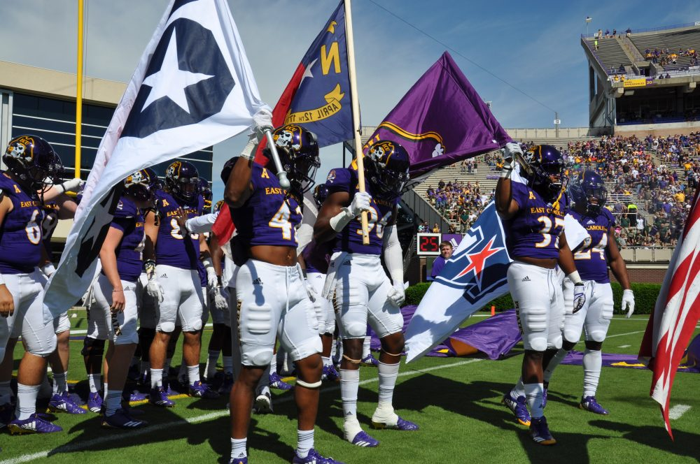 ECU players prepare to take the field before Saturday's game with South Florida. (Photo by Bonesville Staff)