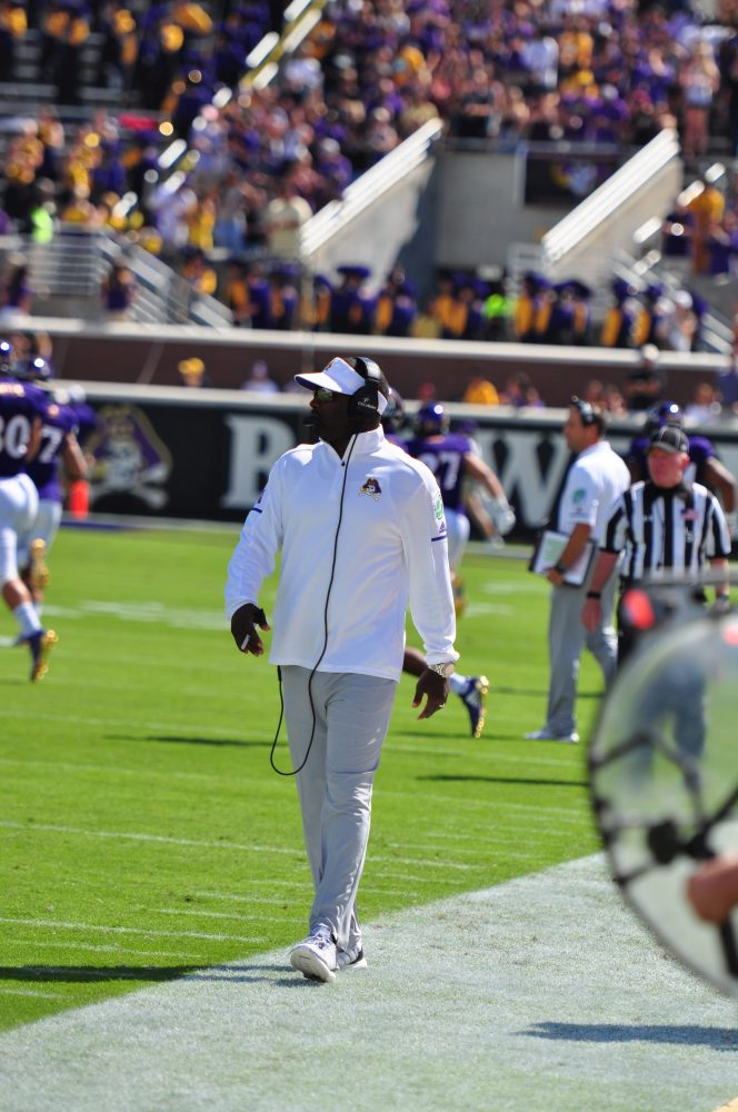 Head coach Scottie Montgomery roams the sidelines before the Pirates AAC home opener against the Bulls. (Photo by Bonesville Staff)