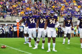 East Carolina's defensive line looks toward the Pirate bench during a break in action. ECU switched to a four-man front for 2017, discarding from the three-man package used in 2016.