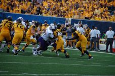 East Carolina defenders combine to stop West Virginia running back Martell Pettaway. (Photo by Al Myatt)