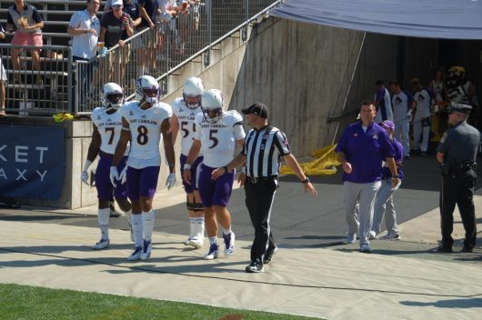 East Carolina's captains come out for the pregame coin toss. The Pirates won and deferred their option to the second half. (Photo by Al Myatt)