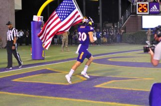 Graduate defensive back Austin Teague brings out the colors for homecoming. (Photo by Al Myatt)