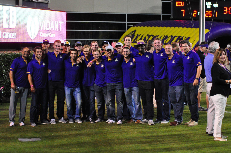 ECU baseball coach Cliff Godwin with members of the Diamond Bucs on Saturday night. (Photo by Al Myatt)