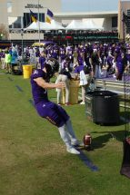 Caleb Pratt, who has consistently put kickoffs in the end zone, takes a practice swing on the sideline.