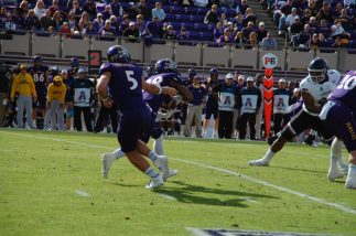 ECU quarterback Gardner Minshew hands off to running back Hussein Howe.