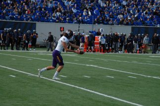Jake Verity makes his first punt of the season in the first quarter. (Photo by Al Myatt)