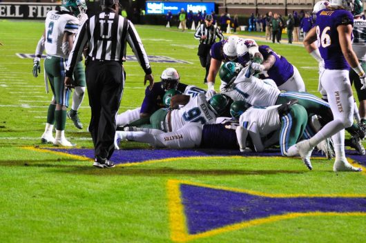 Somewhere in the pile is Darrius Pinnix and the football for ECU's first touchdown on a 2-yard run with 3-09 left in the first quarter. (Photo by Al Myatt)