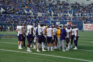 The ECU offense convenes during a timeout before a third down play. (Photo by Al Myatt)