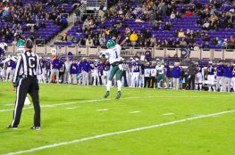Tulane quarterback Jonathan Banks completed this pass but the gain was nullified by holding. (Photo by Al Myatt)