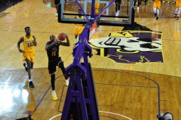 ECU's Kentrell Barkley (15) is cleared for takeoff on a dunk following a steal.