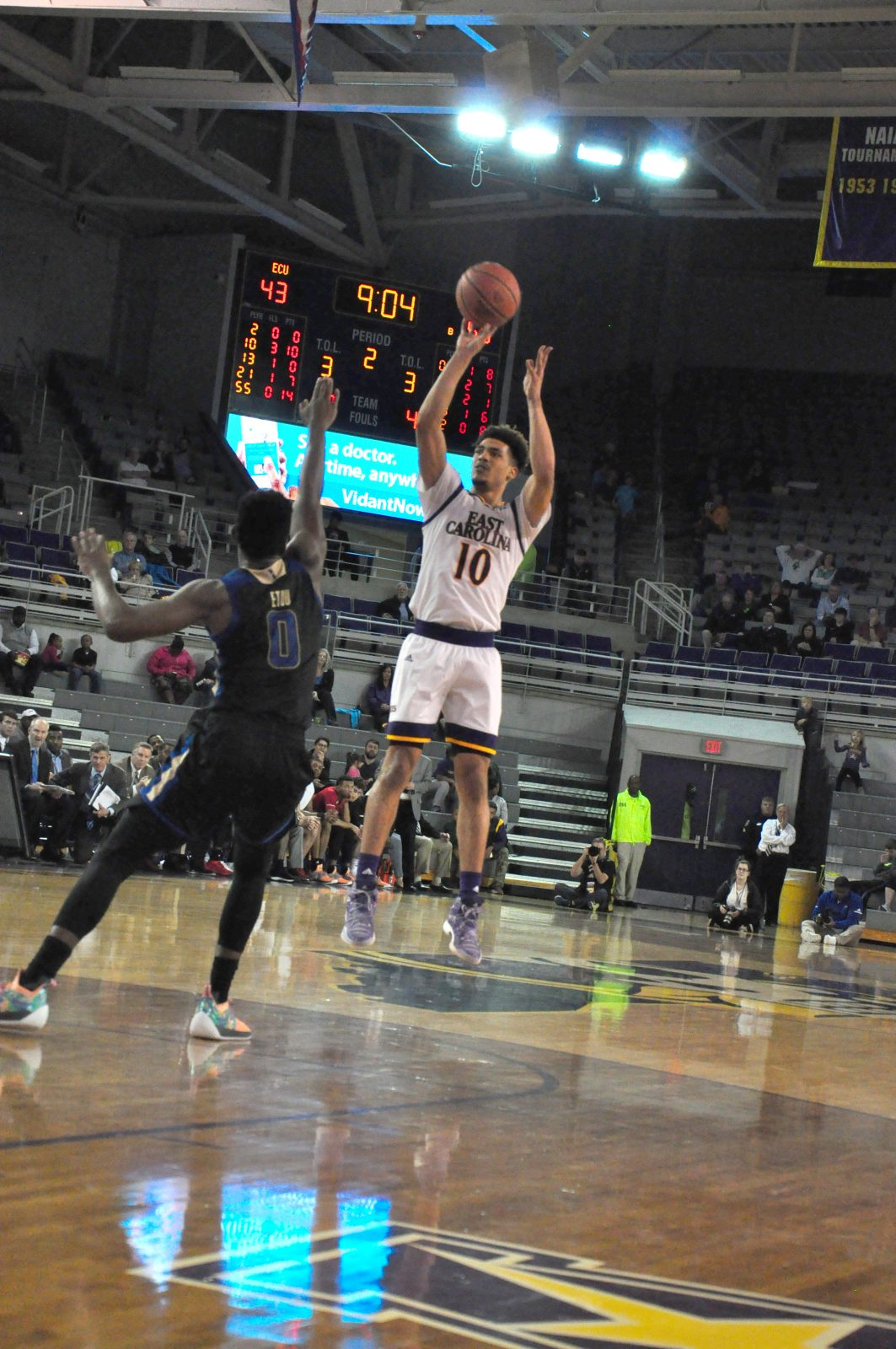 Aaron Jackson takes a jumper in his last home game for East Carolina as a player. (Photo by Al Myatt)