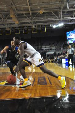 East Carolina point guard Isaac Fleming drives the baseline. He had eight points and six assists before fouling out. (Photo by Al Myatt)