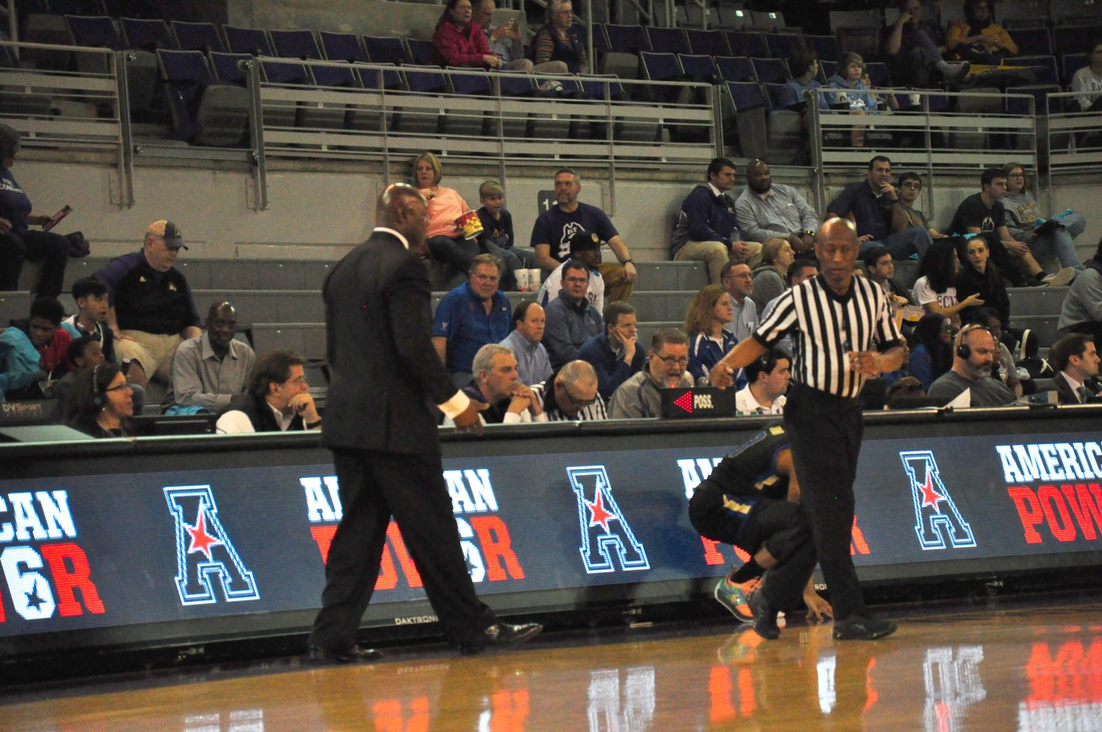 Pirates interim coach Michael Perry has a question for the official after ECU freshman Dimitri Spasojevic picked up his fourth foul. (Photo by Al Myatt)