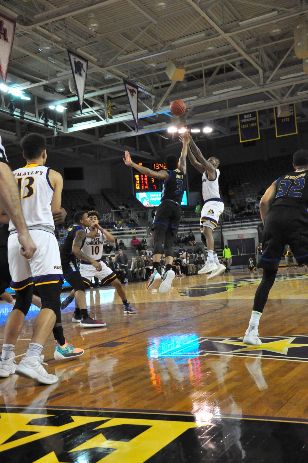 Senior B.J. Tyson, who led the Pirates with 18 points, takes a shot as Elijah Joiner (3) defends for Tulsa. (Photo by Al Myatt)