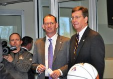 Joe Dooley (center) arrives at Harvey Hall with Lee Workman (right), senior associate athletic director.