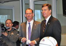 Joe Dooley (center) arrives at Harvey Hall with Lee Workman (right), senior associate athletic director.