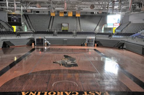 Williams Arena at Minges Coliseum stood empty on Thursday but new basketball coach Joe Dooley charged East Carolina fans with making the facility a difficult place for opponents to play.