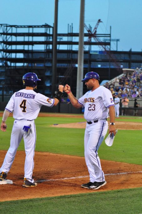ECU coach Cliff Godwin daps up Drew Henrickson during the 16-7 rout of the Seahawks. Henrickson was 1-2 on the night with 3 RBIs. (Photo by W.A. Myatt)