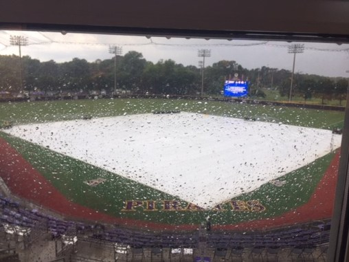 A tarp covered the infield at Clark-LeClair Stadium on Sunday as East Carolina and UNC-Wilmington had a delay in the bottom of the fourth with the Pirates holding a 3-0 lead. (Bonesville photo by Al Myatt)
