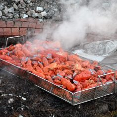 A tray of lobsters sits on a base of seaweed and granite rocks after cooking on Monday. (Photo by Al Myatt)