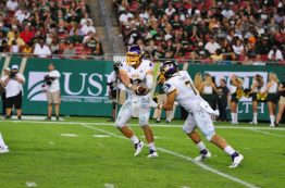 Holton Ahlers (12) and Darius Pinnix execute the read option in a 20-13 loss to South Florida. (Photo by W.A. Myatt)