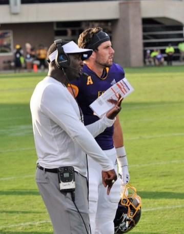 Coach Scottie Montgomery with quarterback Reid Herring. (Photo by Al Myatt)