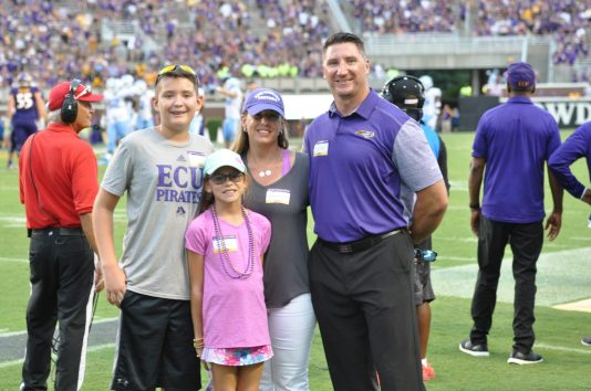 Former Pirates linebacker Jeff Kerr and family enjoyed Saturday's game. (Photo by Al Myatt)