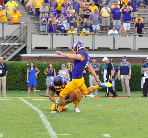Jake Verity came back from having this conversion kick blocked to boot the game winner. (Photo by Al Myatt)