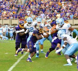 Running back Anthony Scott goes forward for the Pirates. (Photo by Al Myatt)
