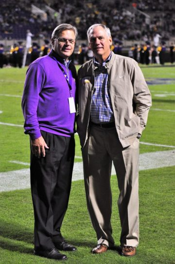 Mark Hessert (left) of the Pirate Club with former ECU basketball coach Eddie Payne prior to halftime ceremonies. (Photo by Al Myatt)