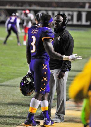 Running back Anthony Scott (3) talks with position coach Jason Nichols. (Photo by Al Myatt)